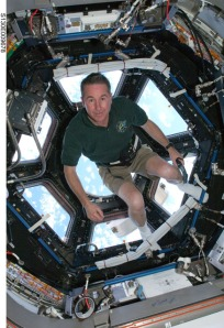 Endeavour astronaut Steve Robinson in front of the cupola.